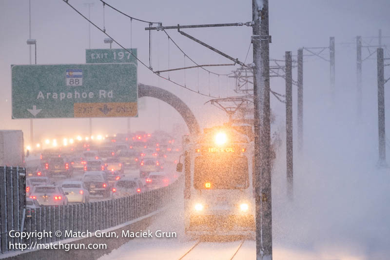 1520-0002-Light-Rail-Train-Emerging-From-The-Snow