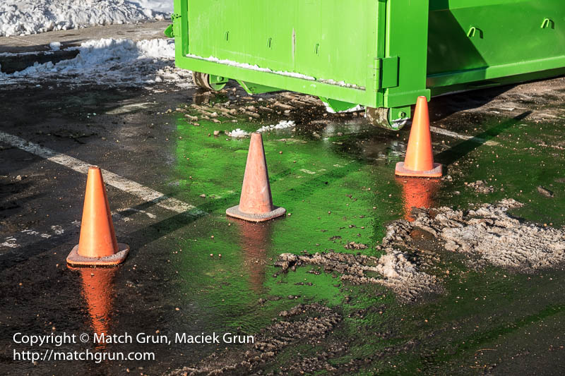 1706-0001-Green-Dumpster-And-Red-Cones-At-The-Office