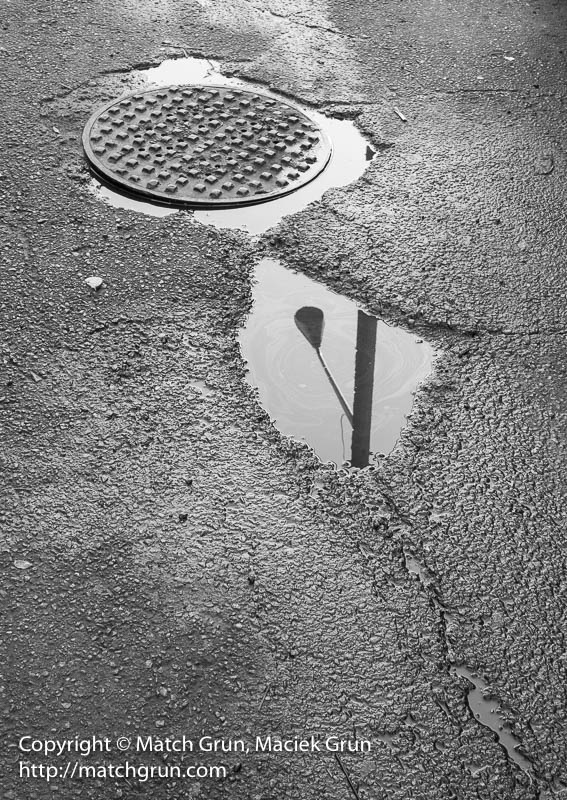 1922-0057-Alley-Reflection-Manhole-And-Streetlight